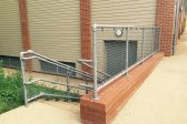 Silver handrails with infill panels