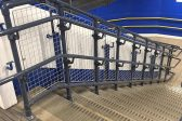 Black handrails with infill panels
