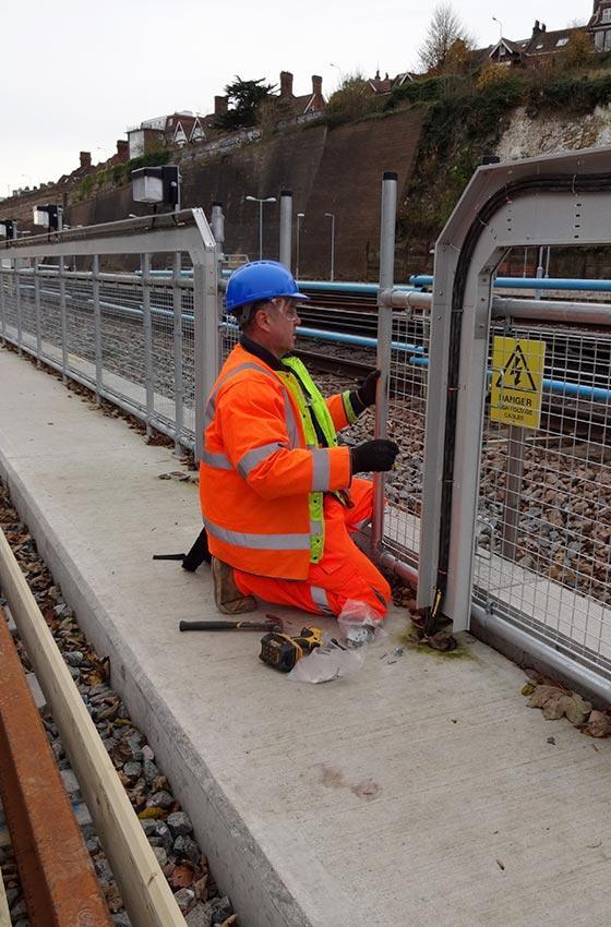 Worker installing guardrail