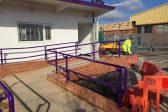 Purple guardrail on a wheelchair ramp